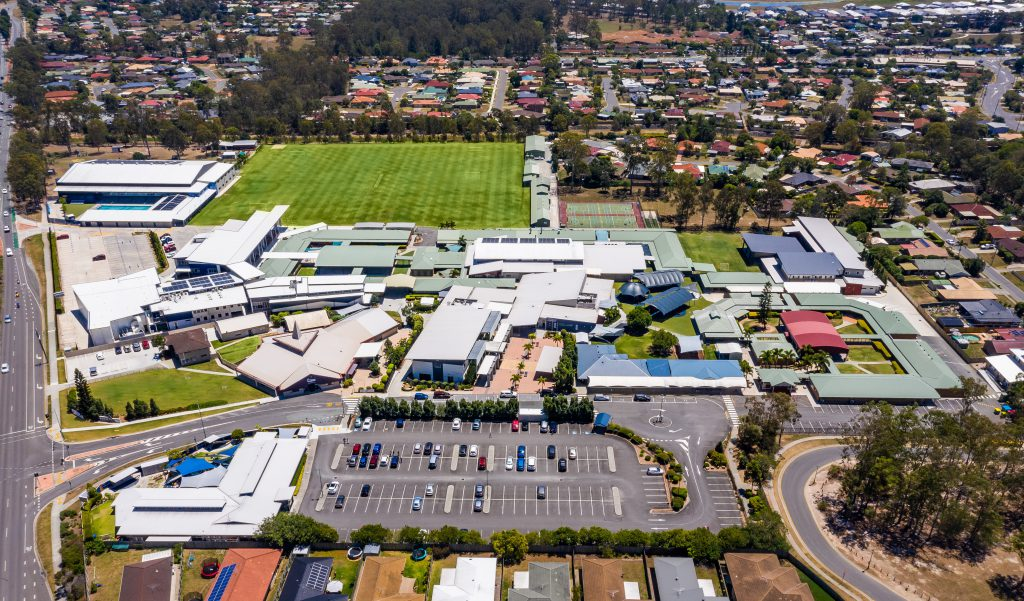 Aerial view of the school campus, buildings and oval