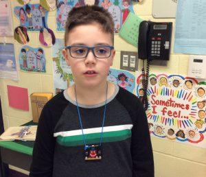 Child wearing a pendant